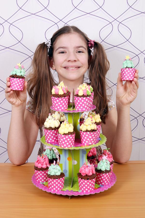 Little girl with sweet muffins dessert stock photography