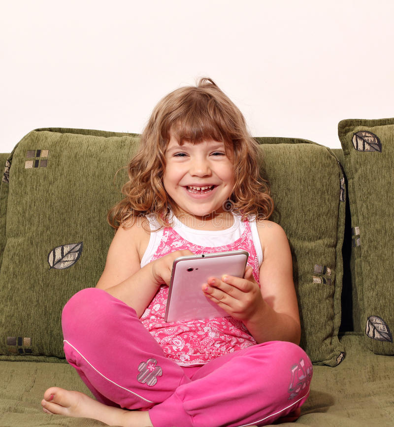 Download Happy Little Girl With Tablet Pc Stock Photo - Image: 27939902
