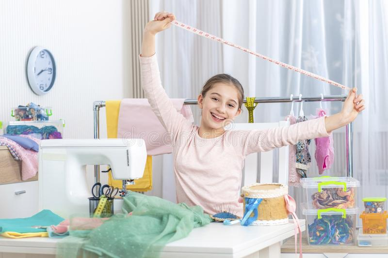Happy little girl with tape measure royalty free stock photo