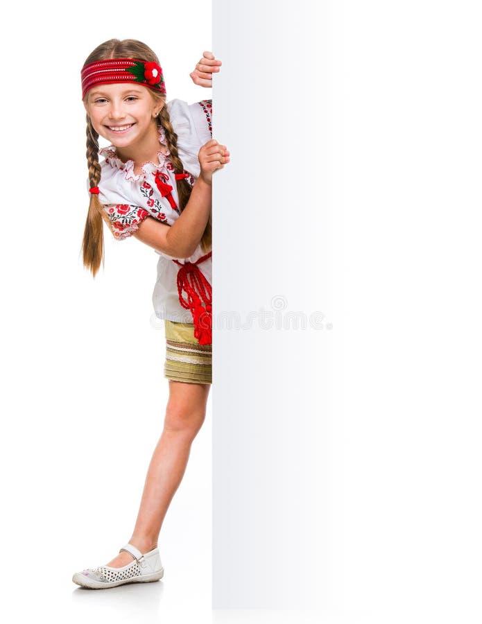 Happy little girl in the Ukrainian national costume stock images