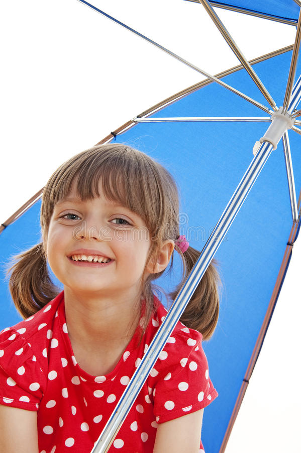 Happy little girl with umbrella royalty free stock image