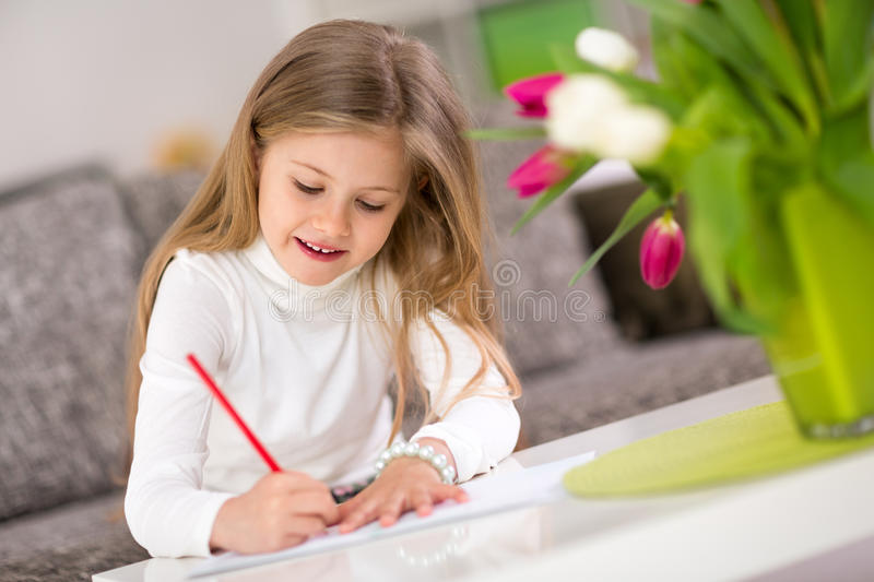 Happy little girl writing royalty free stock photography
