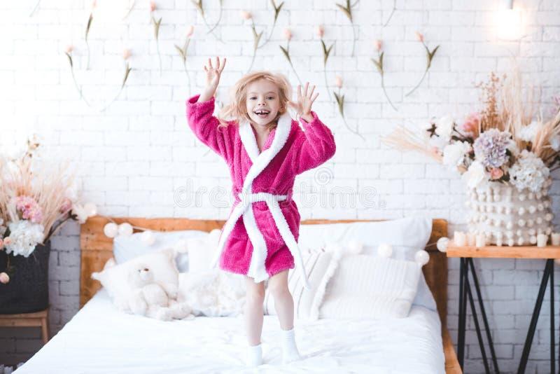 Funny kid girl in room stock photos