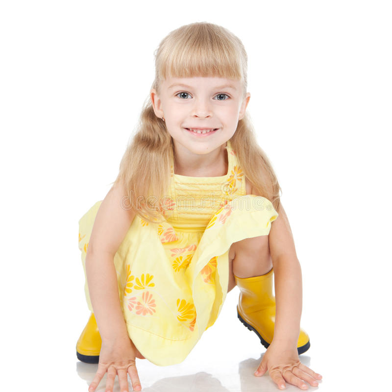 Happy little girl in the yellow boots royalty free stock images
