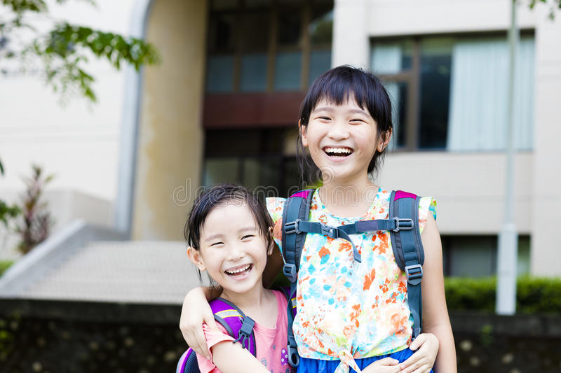 Happy little girls with classmates having fun at the School royalty free stock photos