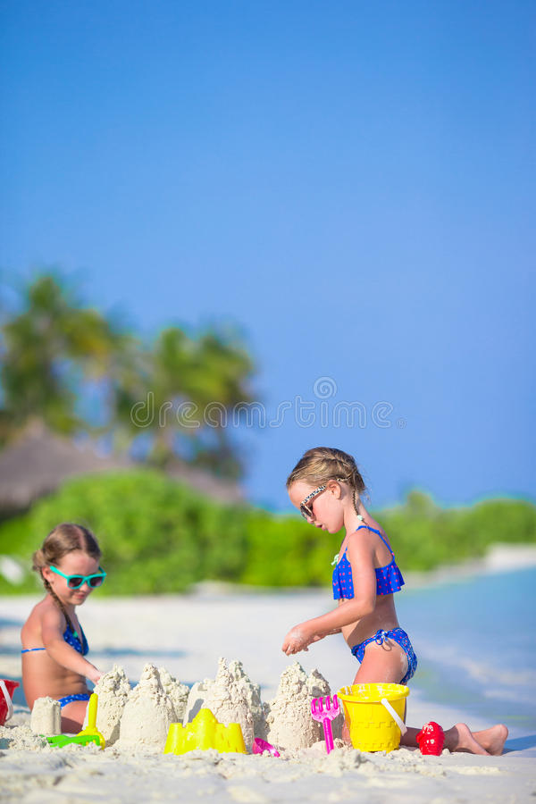Beach Toys For Girls : Happy little girls playing with beach toys during stock