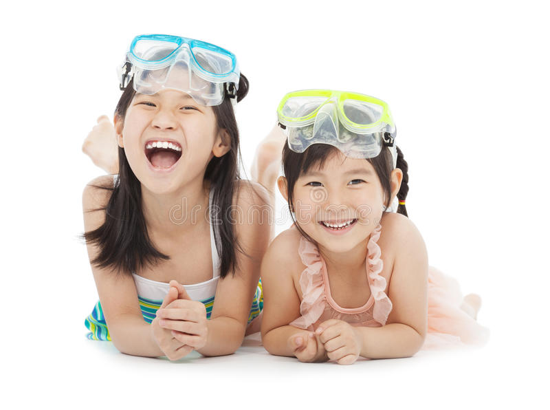 Happy little girls with swimsuit royalty free stock photos