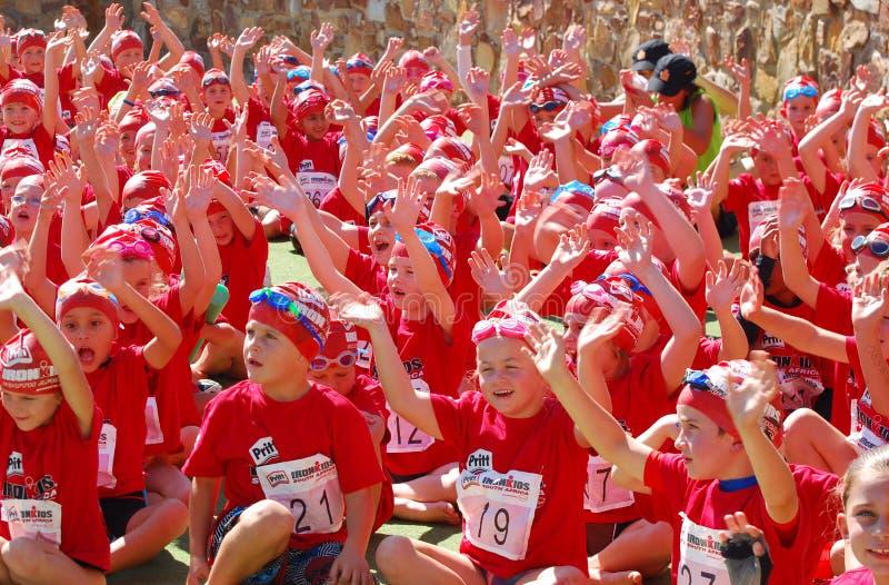 Happy little Ironkids athletes stock photos