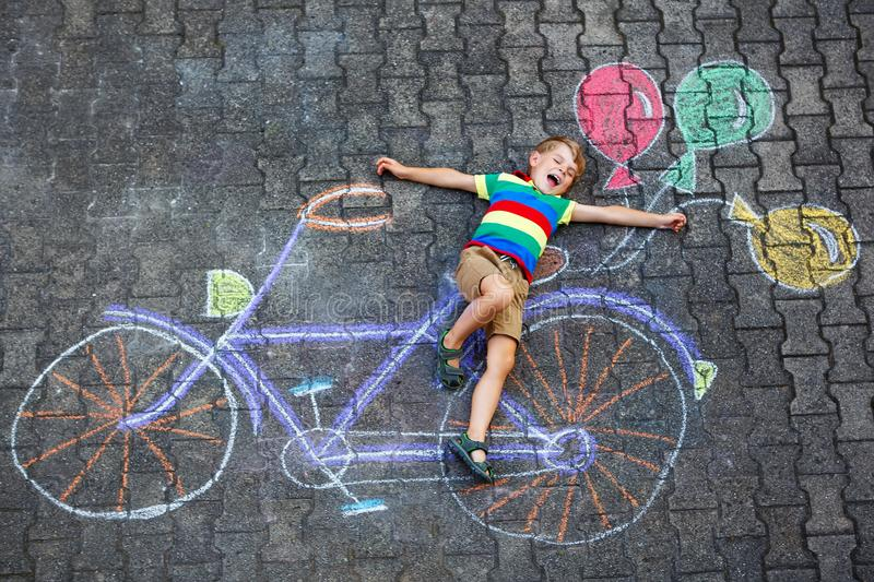 Little kid boy having fun with bike chalks picture royalty free stock photography