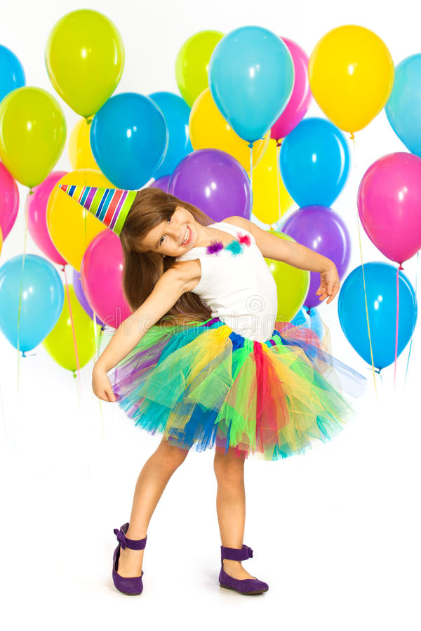 Happy little kid girl with colorful balloons on stock photo