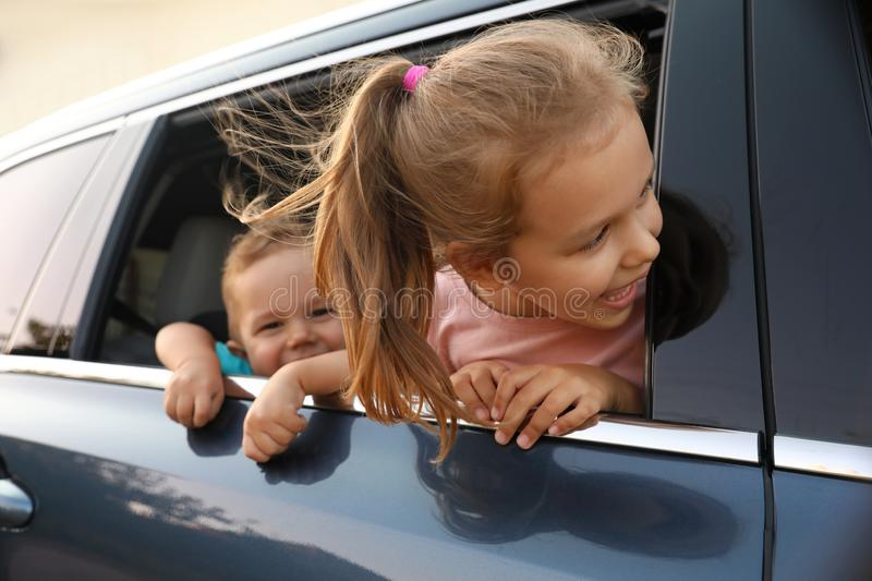 Happy little kids looking from family car royalty free stock images