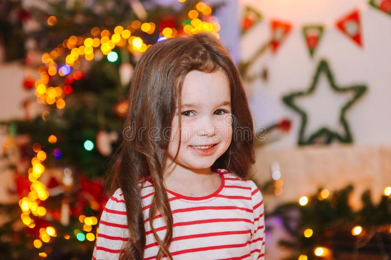 Happy little kids under christmas tree at home royalty free stock images