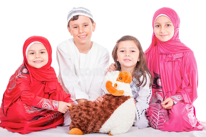 Happy little Muslim kids playing with sheep toy - celebrating Eid ul Adha - Happy Sacrifice Feast stock photos