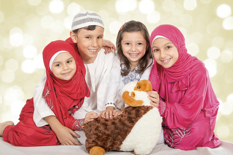 Happy little Muslim kids playing with sheep toy - celebrating Eid ul Adha - Happy Sacrifice Feast royalty free stock photography