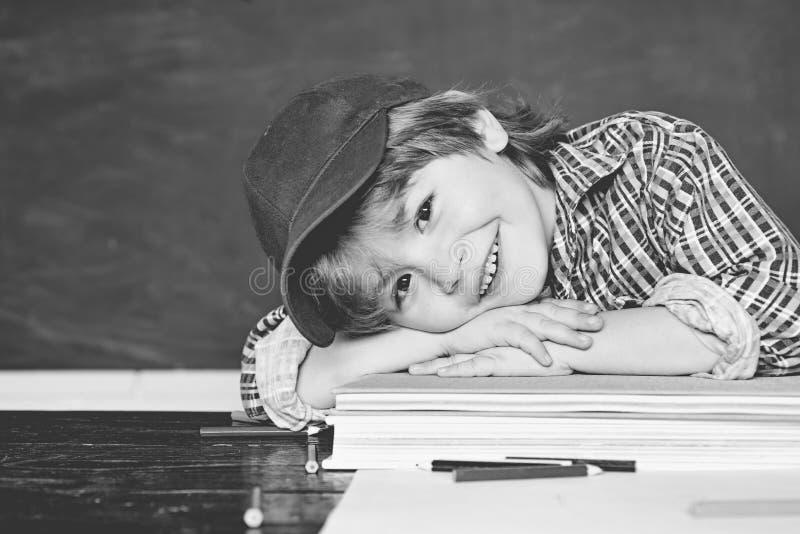 Happy little preschool kid boy in a classroom. Schoolchild. Happy mood smiling broadly in school. Schoolboy. Elementary royalty free stock photography