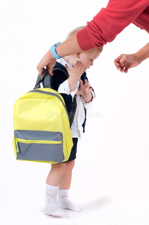 Happy little schoolgirl. Child with backpack and books. Preschool go to school stock photos
