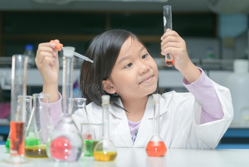 Happy little scientist making experiment stock photography