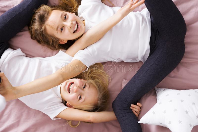 Siblings playing in bed royalty free stock image