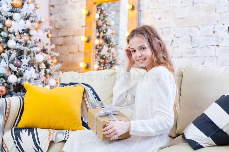 Happy little smiling girl with christmas gift box royalty free stock photography