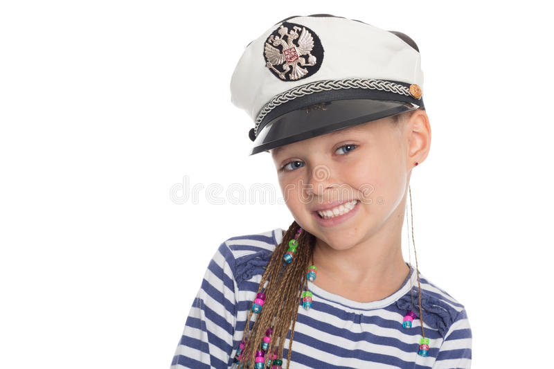 Happy little in a suit cabin boy. Happy little girl six years old in a suit cabin boy. Girl is six years old. On her cap emblem of Russia royalty free stock images