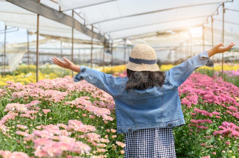 Happy Little traveler on chrysanthemum flower garden stock photos