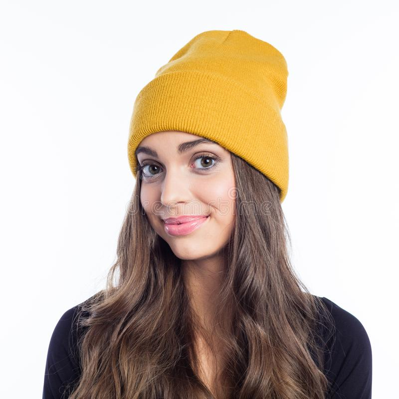Happy long hair young woman in yellow beanie hat stock photos