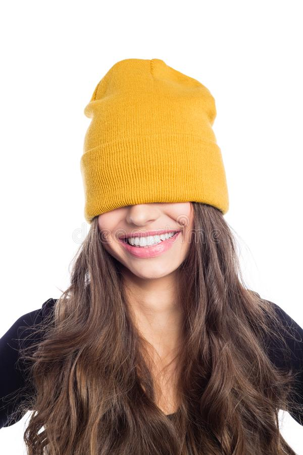 Happy long hair young woman in yellow beanie hat royalty free stock images