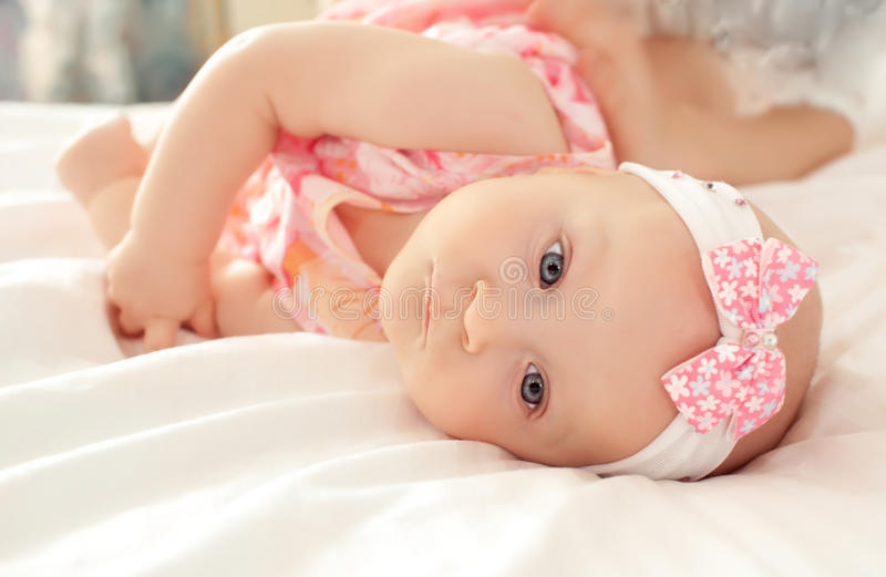 Happy-looking baby wearing knitting hat stock photos