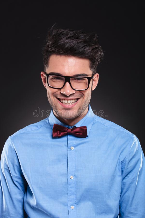 Happy looking guy wearing glasses and suit while smiling stock photos