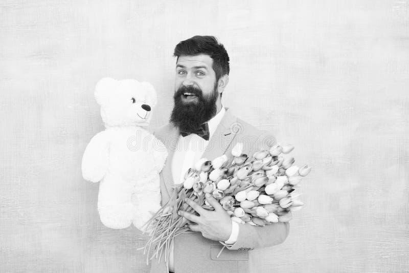 Happy and in love. Gentleman making romantic surprise for her. Gentleman romantic gift. Birthday greetings. Happy. Birthday my love. Man bearded gentleman suit stock photos