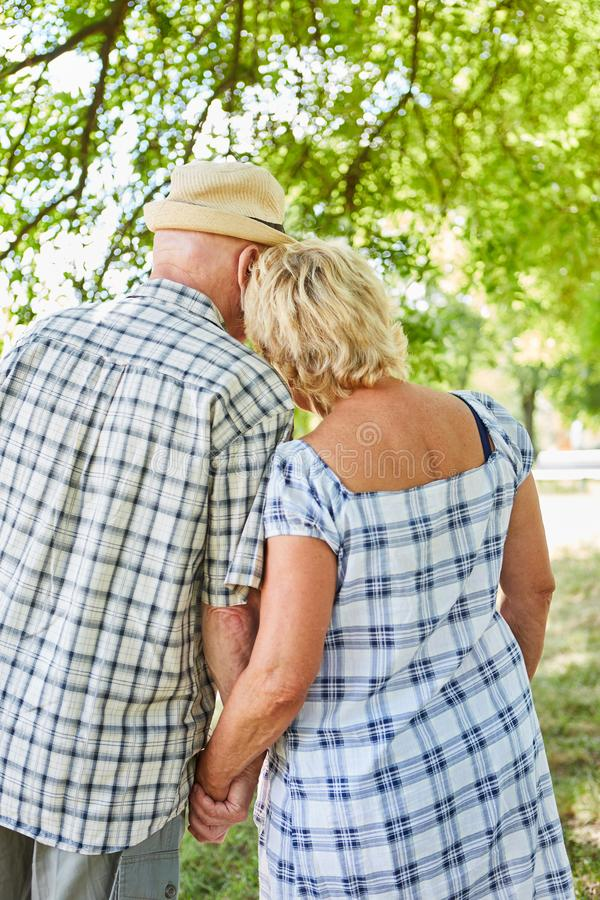 Happy seniors couple in the nature. Happy and in love seniors couple in nature in summer on a tour stock photography