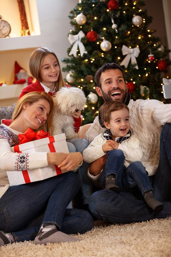 Happy family taking selfie for Christmas together stock photography