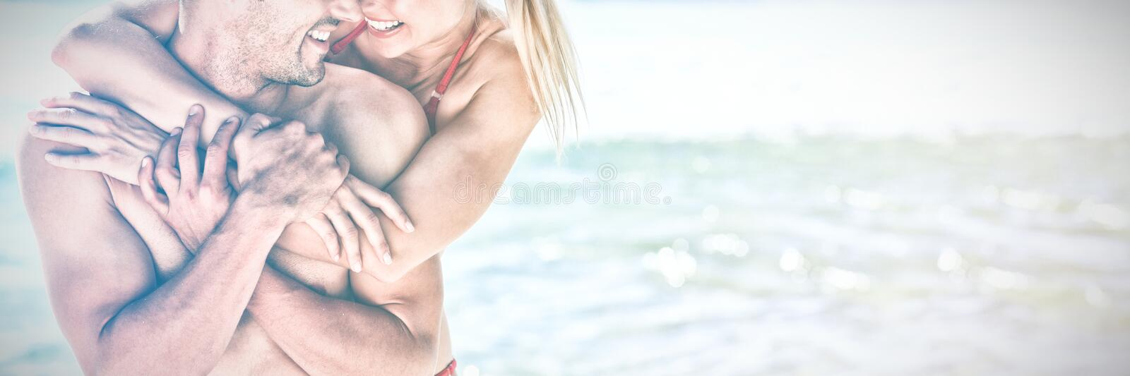 Happy lovers at the beach royalty free stock photo
