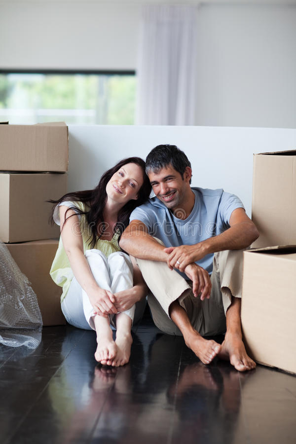 Happy lovers moving house. With boxes royalty free stock photography