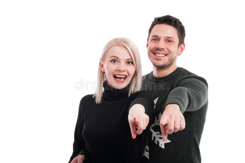 Happy lovers pointing finger at you. Or indicate something on white background with copyspace royalty free stock photos