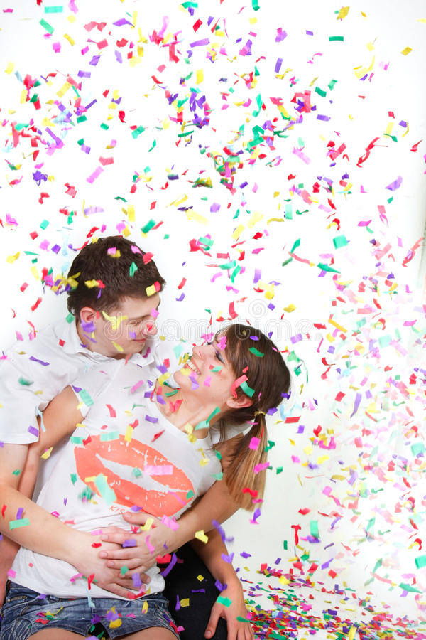 Download Happy Loving Couple In Confetti Stock Photo - Image: 12404370