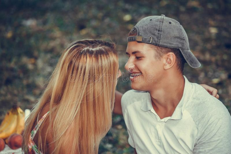 Happy loving couple embracing and kissing outdoors stock image