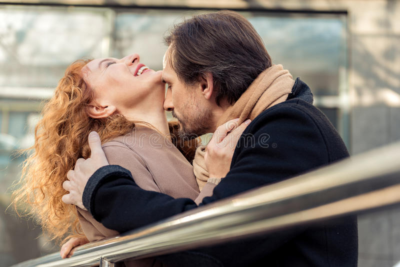 Happy loving couple evincing passion to each other stock image