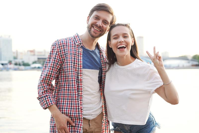 Happy couple on holidays walking around the city and smiling stock photography