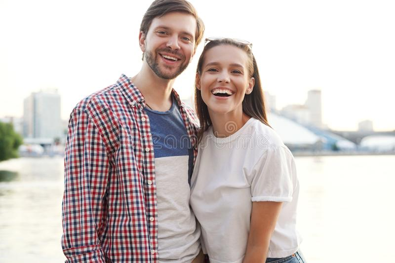 Happy couple on holidays walking around the city and smiling stock photo