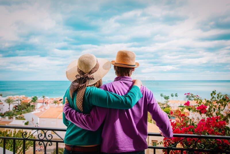Happy loving couple hug on balcony terrace with sea view royalty free stock photos