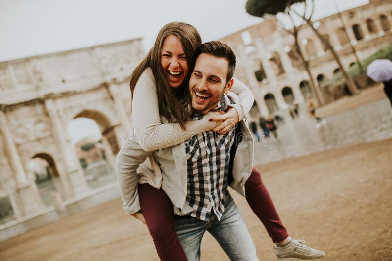 Happy loving couple, man and woman traveling on holiday in Rome, Italy royalty free stock photos