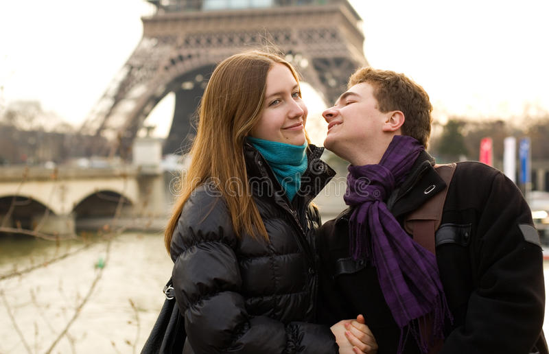 Happy loving couple in Paris. Near the Eiffel Tower royalty free stock photos