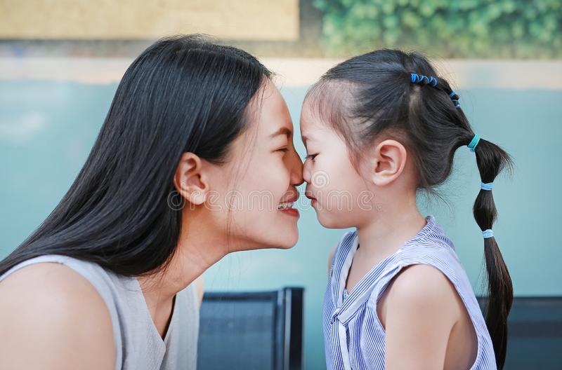 Happy loving family, Close up of mother and child girl kissing stock photography