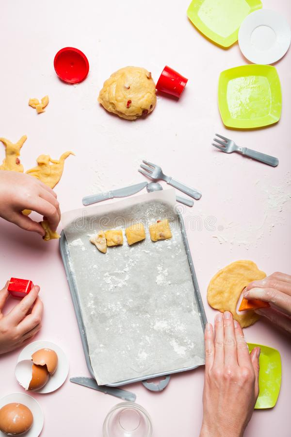 Happy loving family cooks, play bakery together. Child development, motor skills. Scattered toy utensils royalty free stock photo