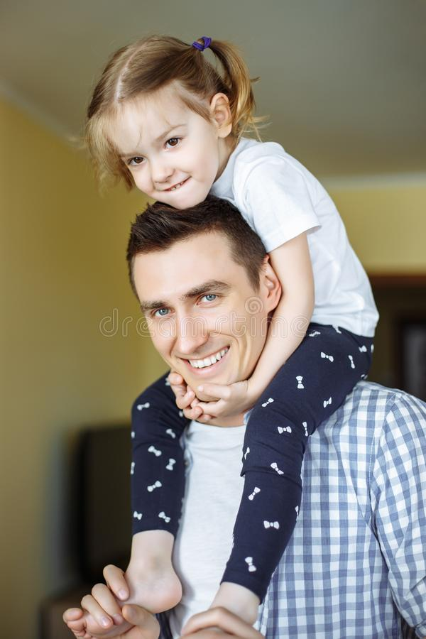 Happy loving family. Father and his daughter child girl playing and hugging. Concept of Father`s day stock image