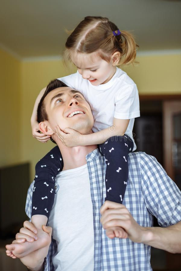 Happy loving family. Father and his daughter child girl playing and hugging. Concept of Father`s day. royalty free stock image