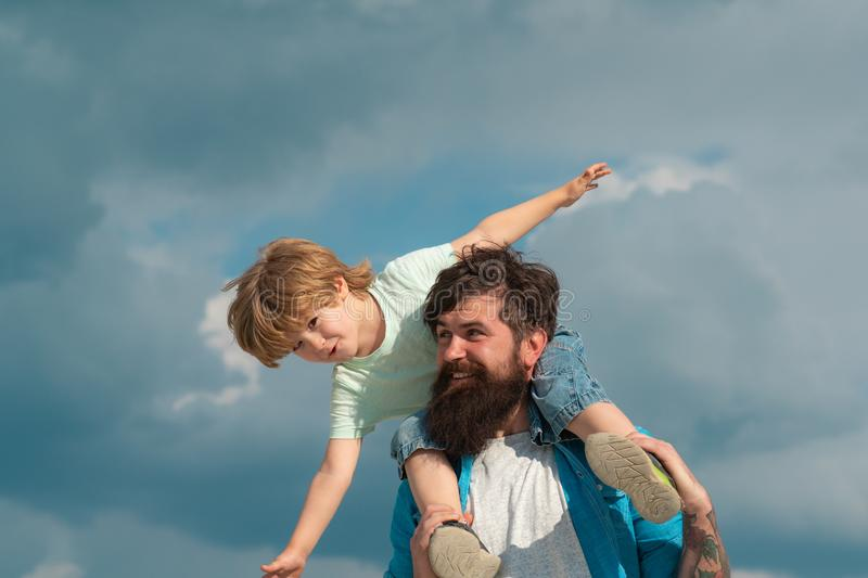 Happy loving family - Father and son. Dream of flying. Happy family father and child on meadow with a kite in the summer. On the nature stock photos