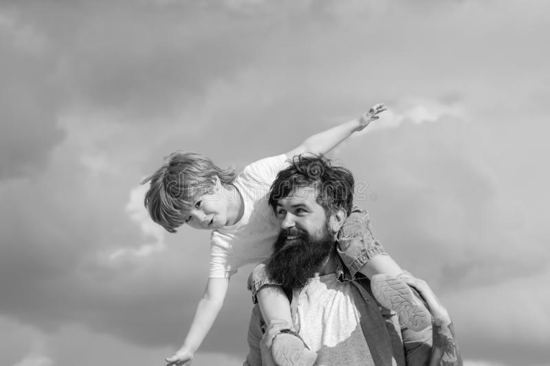Happy loving family - Father and son. Dream of flying. Happy family father and child on meadow with a kite in the summer. On the nature royalty free stock photography