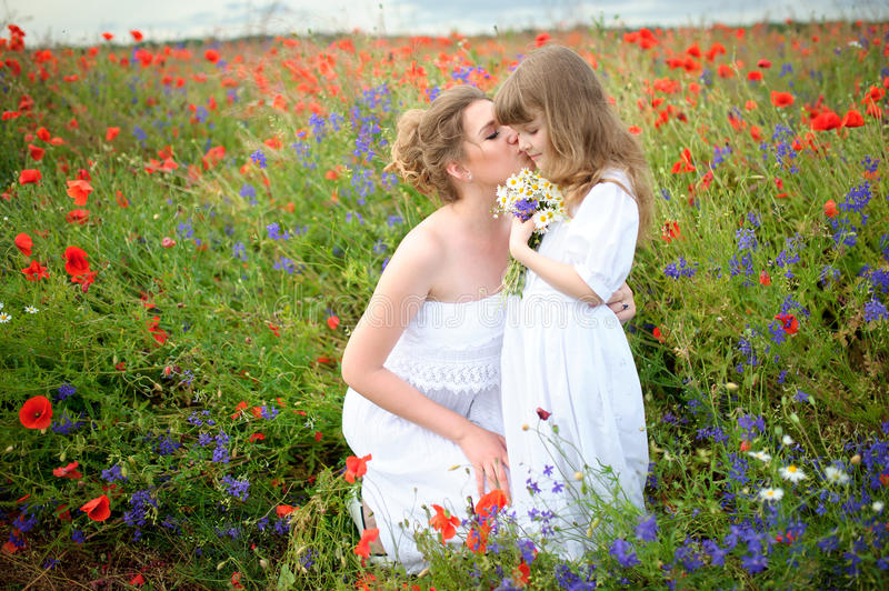 Happy loving family. Mother and child girl playing and kissing. royalty free stock photos